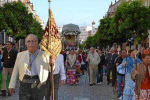 La Hermandad de La Palma. a su paso por la calle Real. (Carlota Cabello)