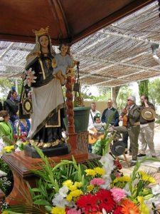 Misa a la Virgen en la romería de Mazagón.