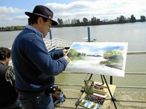 Un pintor a orillas del Guadalquivir.