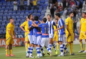 Jugadores del Recreativo celebrando el gol. (Espínola)
