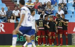 Jugadores del Recreativo celebrando la victoria en Zaragoza. (www.marca.com)
