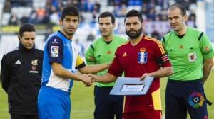 Córcoles y Antonio Hidalgo, capitanes de Recreativo de Huelva y Sabadell.