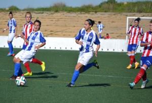 Paula y Virgy, jugadoras del Cajasol Sporting ante el Atlético de Madrid.