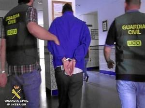 Imagen de archivo del momento de la detención del único acusado por el doble crimen de Almonte.