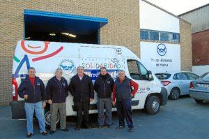 Banco de Alimentos de Huelva presidente con voluntarios