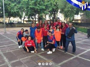 Jugadoras del Sporting con Avadi Down.